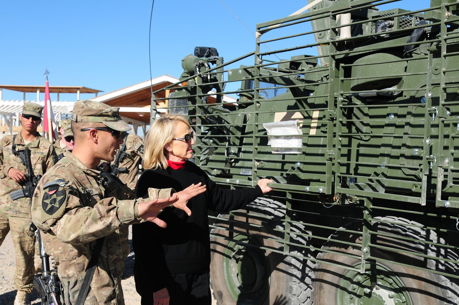 Sgt. 1st Class Jason Packard, assigned to 8th Squadron, 1st Cavalry Regiment , 2nd Stryker Brigade Combat Team, 2nd Infantry Division and attached to Task Force Steel at FOB Frontenac, explains some of the capabilities of the Stryker vehicle to AZ. Gov.