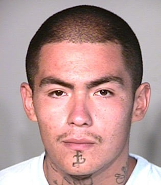 (Source: Coconino County Sheriff's Office) Andrew Jaurequi is accused of holding down the victim while Sanchez III attacked the victim with a machete.