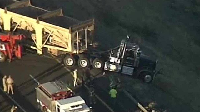 (Source: CBS 5 News) A tractor-trailer crashed through a guard rail Friday afternoon that left it hanging over a canyon on southbound I-17 near Sedona.