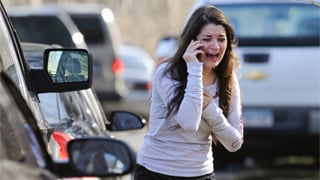 (Source: AP) A woman waits to hear about her sister, a teacher, following the shooting.