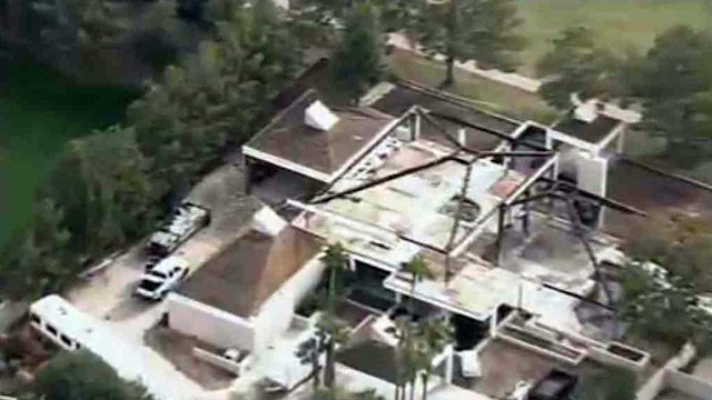 (Source: CBS 5 News) A heavy garage door fell and killed a worker at a mansion once set ablaze by its previous owner, Michael Marin, who committed suicide during his arson trial.