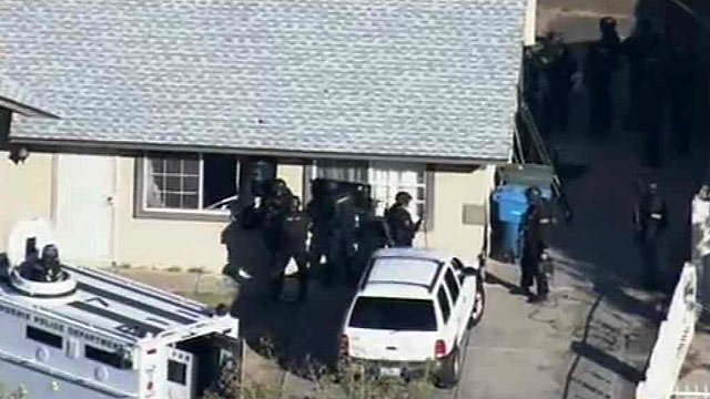 (Source: CBS 5 News) The man barricaded himself in the home near 69th Avenue and Garfield Street with his wife and two children about 9 a.m. Wednesday.