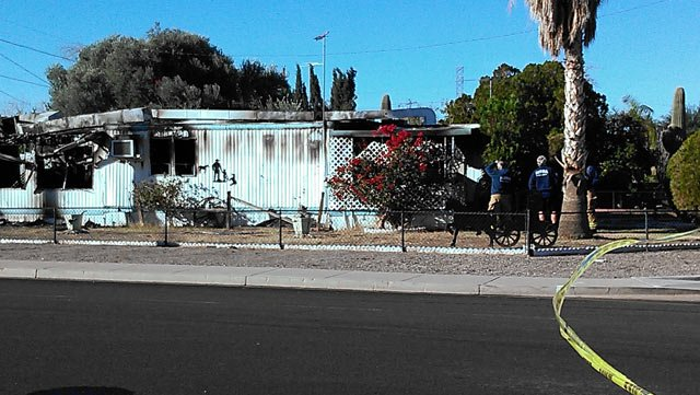 (Source: Colton Shone / CBS 5 News) Mesa firefighters said an elderly woman was found dead after a fire inside this mobile home.