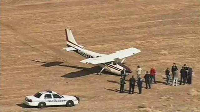 (Source: CBS 5 News) Four people walked away uninjured after their small plane was forced down in a field near Chandler Municipal Airport on Monday.