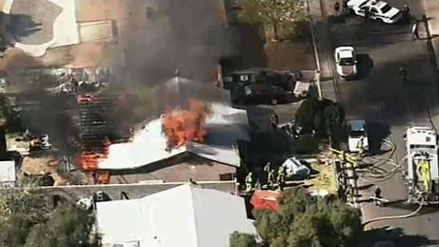 (Source: CBS 5 News) A fire tore through the attic of this Phoenix home on Wednesday morning.