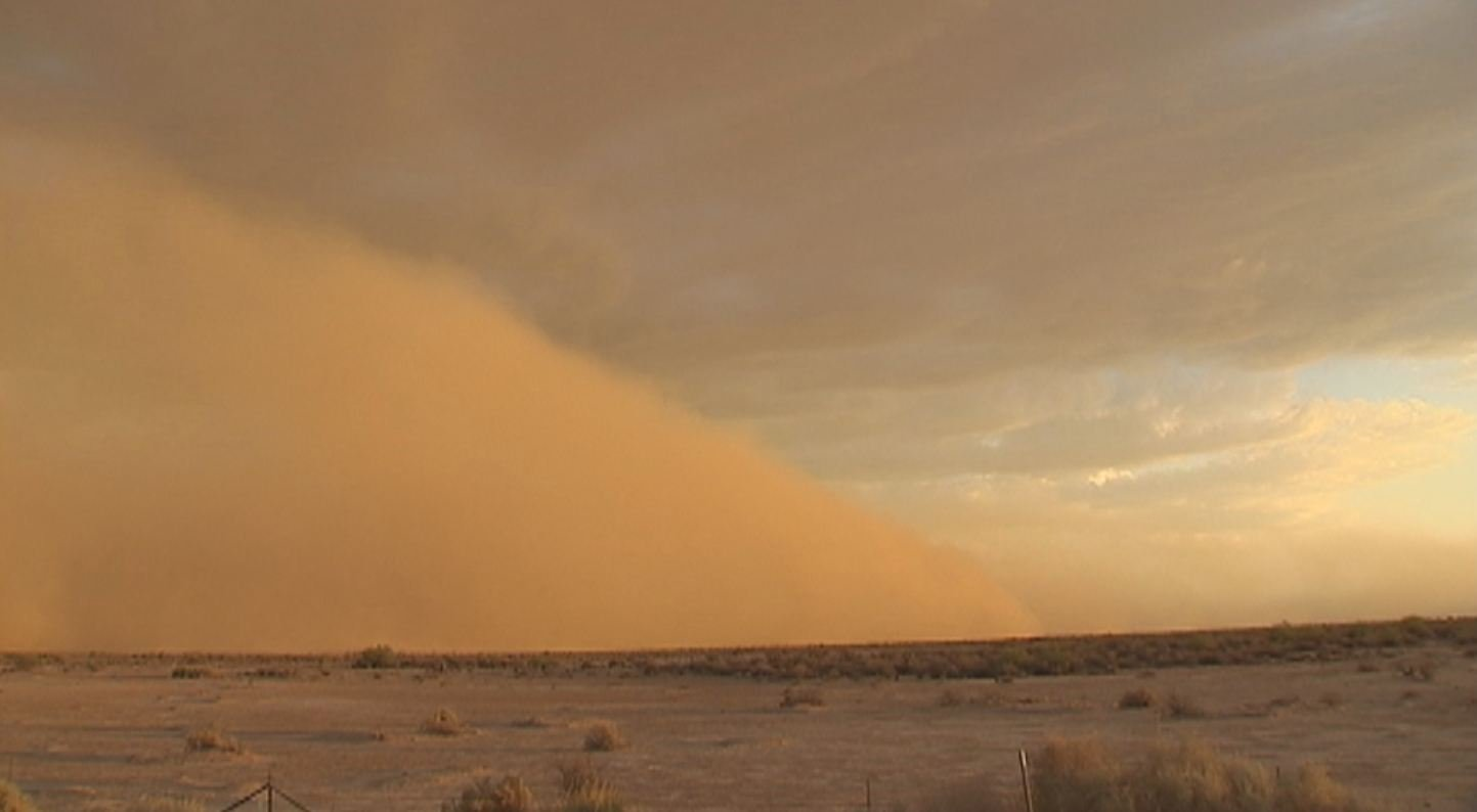 A dust storm rolls through the desert.