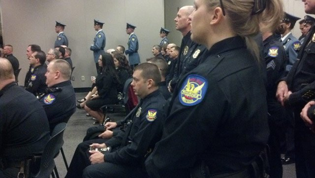 (Source: Christina Batson / CBS 5 News) Some Phoenix police officers retook their oaths of office Thursday.