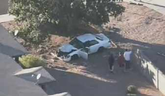 Car plows through wall in Mesa