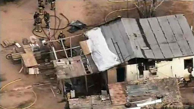 (Source: CBS 5 News) Two adults and a child escaped this home unharmed during a house fire in Buckeye on Monday morning.