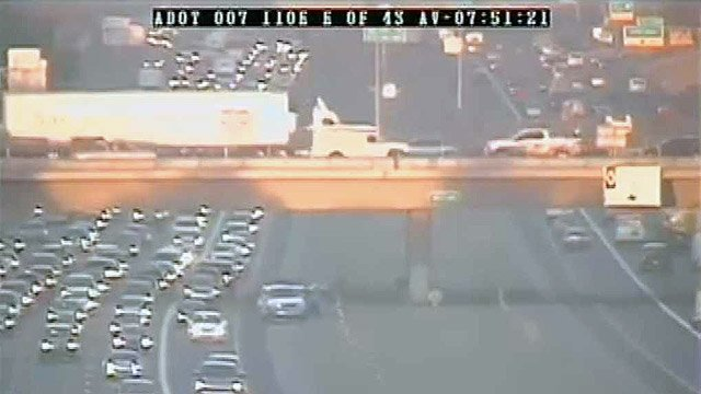 (Source: ADOT freeway camera) A pregnant woman pulled to the side of I-10 after her water broke during rush hour..