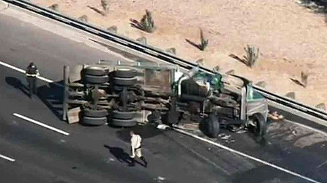(Source: CBS 5 News) A sewage truck rear-ended a passenger car, rolled and forced the closure of westbound I-10 near 24th Street Wednesday morning.