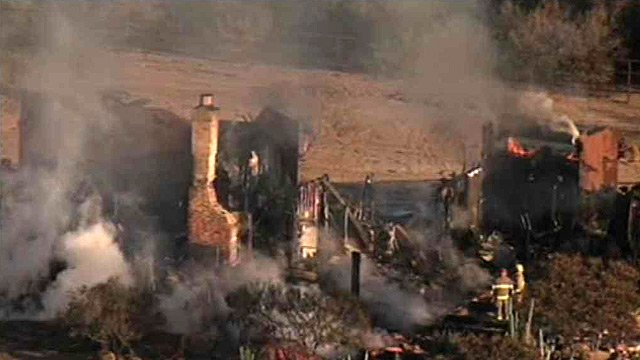 (Source: CBS 5 News) This house was a total loss after a fire Tuesday morning.