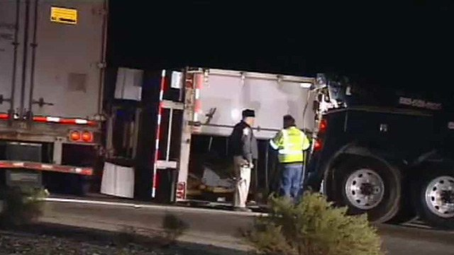 (Source: CBS 5 News) A semi carrying flooring materials tipped on its side, closing one lane of I-10 in Buckeye on Wednesday morning.