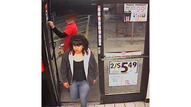 (Source: Phoenix Police Department) This woman  and an accomplice robbed a Circle K store of two cases of beer.