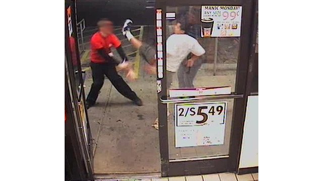 (Source: Phoenix Police Department) The man kicks at the Circle K employee.