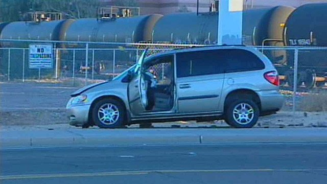 (Source: CBS 5 News) Tempe police say a woman drove this minivan around the crossing gates and was hit by a freight train.