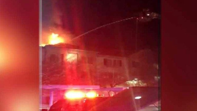 (Source: Phoenix Fire Department) Flames roared through the roof of the two-story complex, forcing firefighters to escalate the fire to a second alarm.
