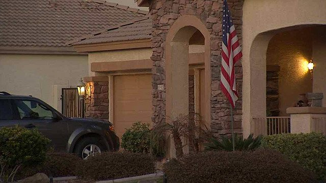 (Source: CBS 5 News) A Mesa woman says the fatal shooting of her husband at this house was accidental.