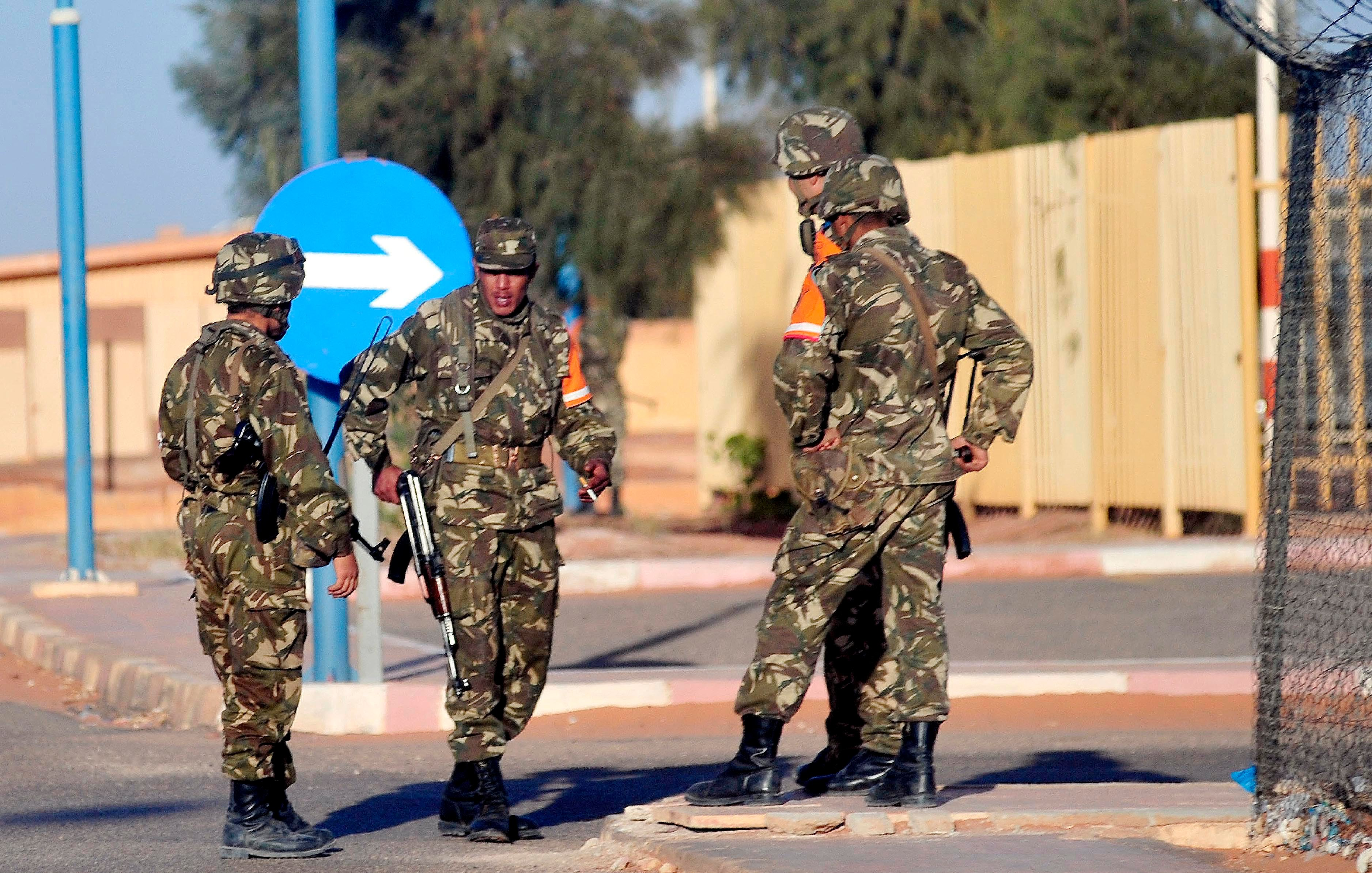 (Credit: AP Photos) In this photo released by China's Xinhua News Agency, Algerian soldiers secure the airport in Ain Amenas, Algeria, before the departure of freed hostages Saturday, Jan. 19, 2013.