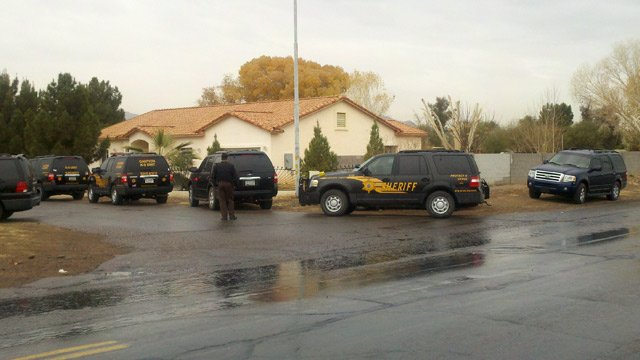 (Source: Jose Miguel / CBS 5 News) Deputies armed with assault rifles swarmed the scene near 65th and Southern avenues after a suspect shot at a woman and deputy.