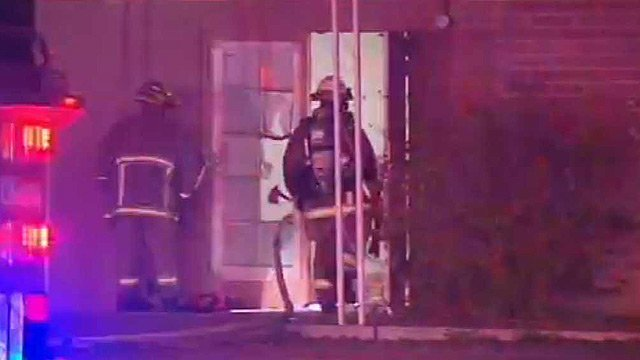(Source: CBS 5 News) Phoenix firefighters battle a fire Tuesday morning in a brick building near Baseline Road and Central Avenue in south Phoenix.