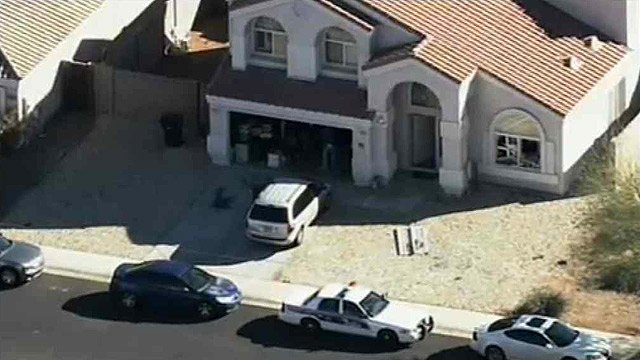 (Source: CBS 5 News) A man and woman barricaded themselves in the house near 111th Avenue and Union Hills Drive, but they were eventually taken into custody.