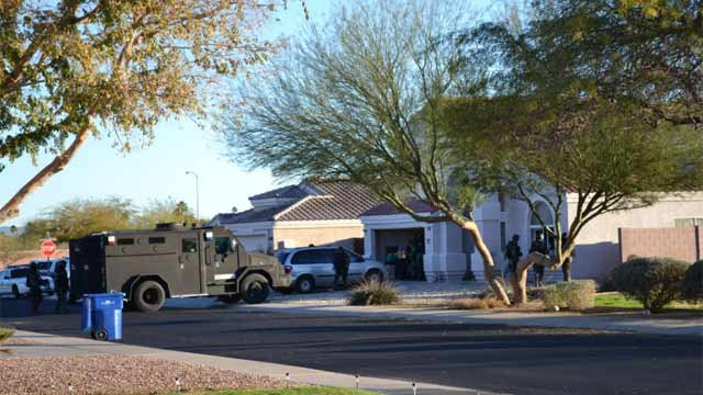 (Source: Mike Boyle) SWAT officers move in as the barricade situation unfolds.