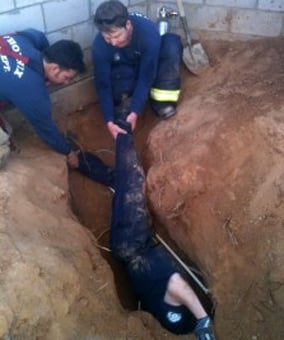 Scottsdale police and Phoenix fire crews dug a hole to reach to stranded pooch. (Source: Arizona Humane Society )