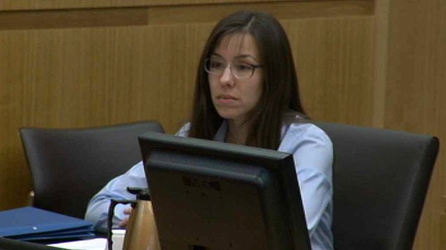 (Source: CBS 5 News) Jodi Arias listens to testimony on Tuesday during the first day of her defense. She is accused of murdering Travis Alexander in 2008.