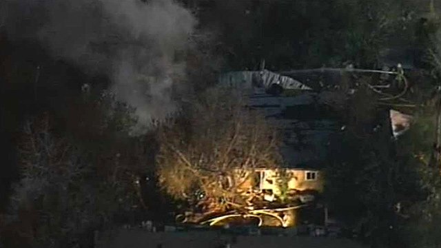 """(Source: CBS 5 News) Colin Williams of Rural-Metro fire said firefighters were met with """"tons of debris"""" in the house that comprised a number of add-on rooms near University Drive and Loop 202."""