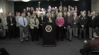 Monday's press conference was packed with business leaders and lawmakers.