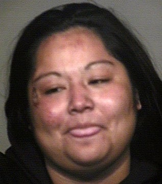 (Source: Mesa Police Department) Police said Christine M. Carlos walked into traffic on Country Club Drive about 3 p.m., causing motorists to slam on their brakes and swerve to avoid hitting her.