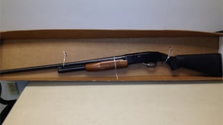 The loaded gun that was taped to the back of the sign. (Source: Mesa Police Department)