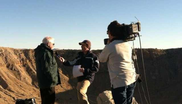 CBS 5 News' Sean McLaughlin interviews Astronomer Larry Wasserman at Meteor Crater on Friday.