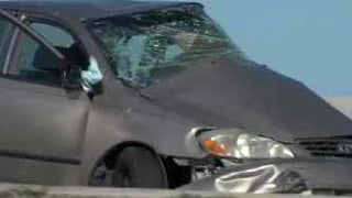 The two-car collision occurred in the southbound lanes at Red Mountain Freeway.