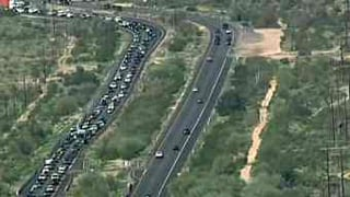 Traffic backed up for miles on US 60 in Gold Canyon.