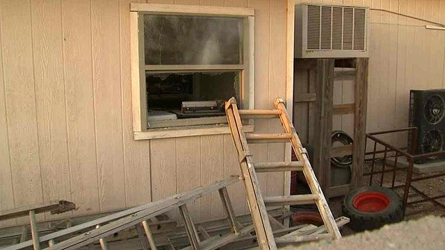 (CBS 5 News) Little was bound and locked into this storage shed. He was able to escape through this window and leaped a fence to safety at a neighbor's house.