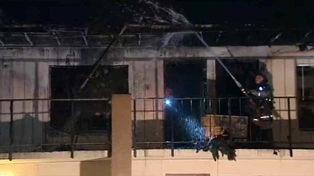 (Source: CBS 5 News) The fire broke out about 12:30 a.m. in a vacant second-floor unit and spread to an occupied apartment next door.