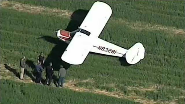(Source: CBS 5 News) Two people emerged unscathed Thursday after the pilot was forced to land the airplane in which they were riding in a field south of Chandler Municipal Airport.