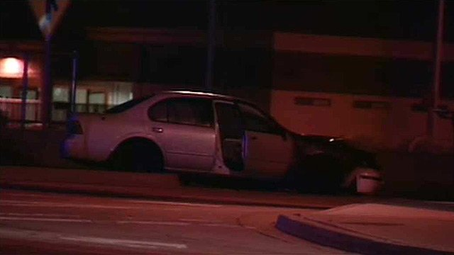 (Source: CBS 5 News) A car's engine caught fire after its driver lost control and hit a curb in Tempe late Thursday night.