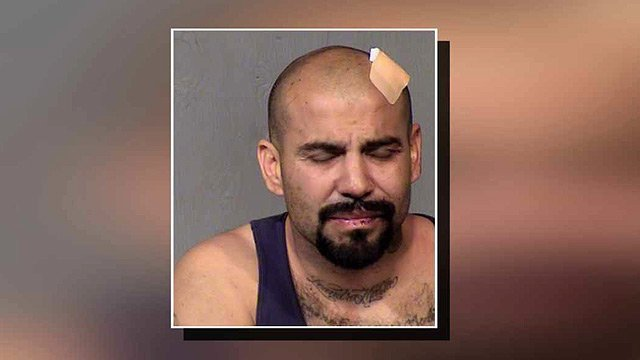 (Source: Maricopa County Sheriff's Office) Lawrence Aguirre, 40, got kicked out of the Oz Bar after a fight with his girlfriend. A couple hours later he came back - with an ax.