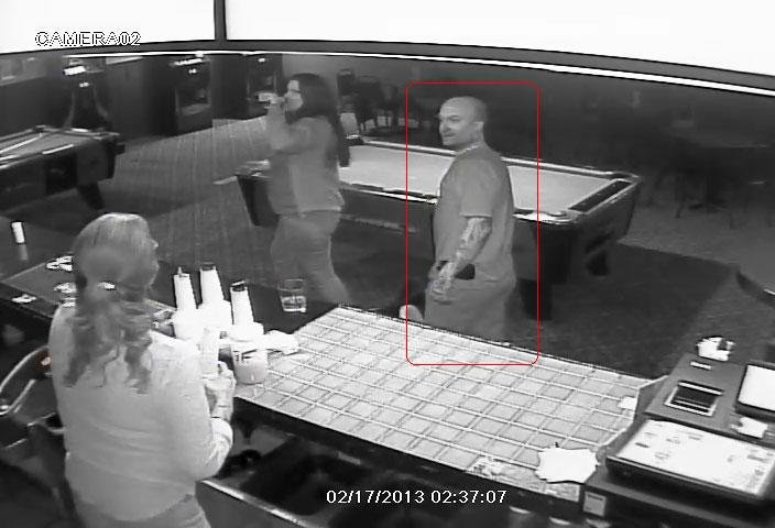 Surveillance image from inside the Outlaw Saloon. Authorities are looking for the man in red. (Source: Pima County Sheriff's Department)
