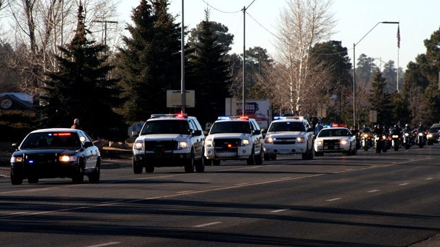 The body of Staff Sgt. Jonathan D. Davis, 34, passed through Flagstaff and was escorted by emergency vehicles and military veterans on motorcycles. (Source: Calvin Johnson / Leupp)