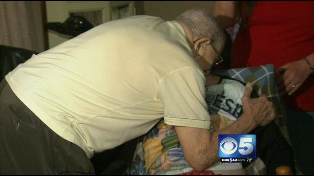 Jim Sexton hugging Marlene Lovitt Saturday night. (Source: KPHO-TV)