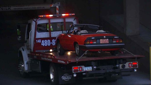 A red convertible Alfa Romeo believed to have been involved in the fatal hit-and-run involving a Phoenix woman is brought to the Phoenix Police Department's crime lab. (Source: CBS 5 News)