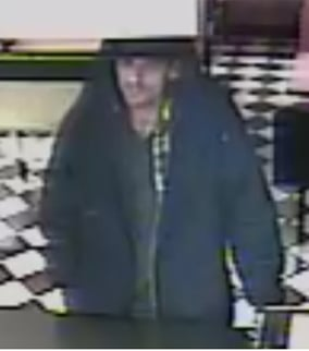 Surveillance camera captures suspect at Taco-Mex. (Source: Silent Witness)