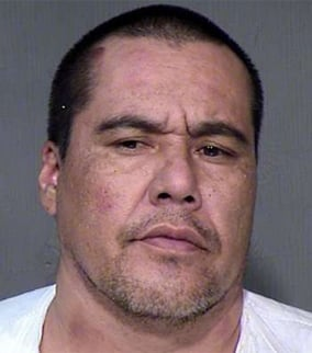 New mug shot of Champagne after he was re-booked on March 6, 2013.