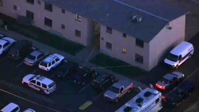 Two people were found shot to death, but a 4-month-old baby was still alive after an apparent homicide in Phoenix early Wednesday morning. (Source: CBS 5 News)