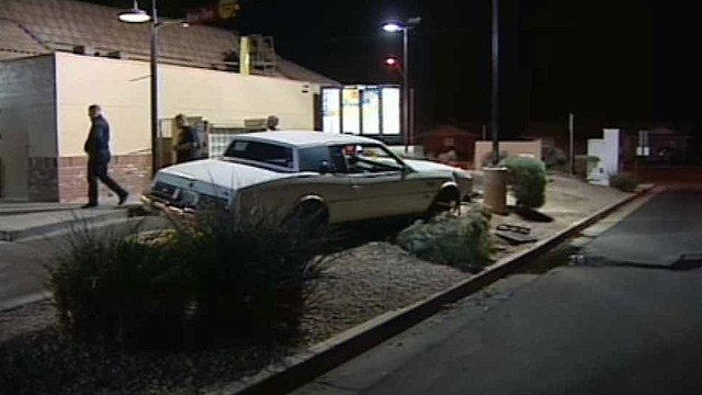 Glendale police said the driver and his juvenile passenger were both under the influence when the driver jumped the curb by the drive-in and hit and broke the water line. (Source: CBS 5 News)