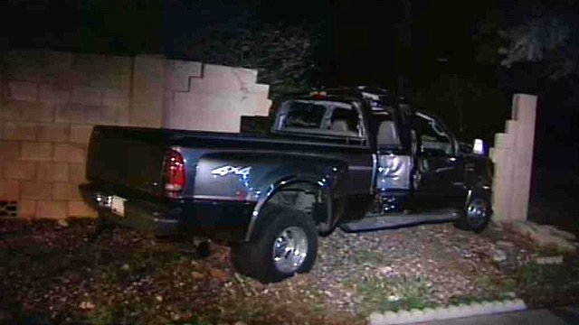 This pickup truck took out a power pole near a Phoenix backyard before crashing into a wall early Tuesday morning. (Source: CBS 5 News)